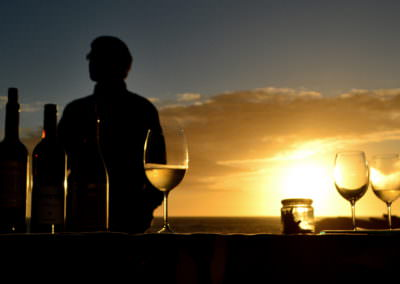 Wine tasting as the sun sets over the Atlantic Ocean.